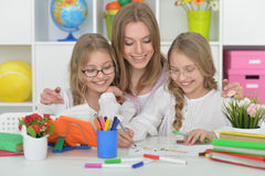 Girls  with mother on lesson of art Royalty Free Stock Photography