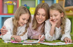 Girls  with mother on lesson of art Stock Images