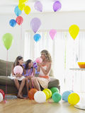 Girls And Mother In Room Full Of Balloons Stock Photos