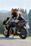 Girls on a motorcycle. Two pretty young sexily girls on a motorcycle Royalty Free Stock Photos