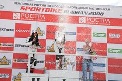 Girls-motorcyclists On Pedestal Stock Image