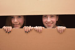Girls in moving box royalty free stock images