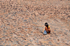 A girls in Mui ne fishing village. A little girls was picking conch in mui ne fishing village Royalty Free Stock Photography