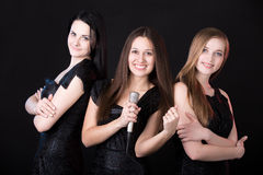 Girls music band with microphone Royalty Free Stock Image