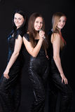 Girls music group with microphone Royalty Free Stock Photography