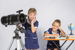 Girls mysteriously astronomers thinking Royalty Free Stock Images