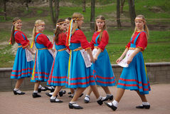 Girls in national costumes dance Royalty Free Stock Photo