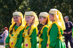 Girls in national costumes at the festival Tatar Sabantuy Stock Images