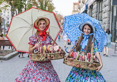 Girls in national costumes sell sweets in Kiev, Ukraine. Stock Image