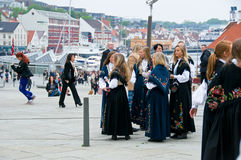 The girls in national suit in Stavanger. The girls in a national suits on the streets at norwegian constitution day in Stavanger royalty free stock photography