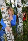 Girls near birches Stock Photo