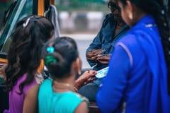 Girls Near Man Holding Money Stock Photo