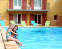 Girls  near the open-air swimming pool Stock Image