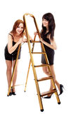 Girls near step-ladder Royalty Free Stock Photos