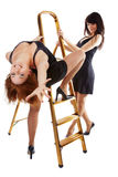 Girls near step-ladder Royalty Free Stock Image