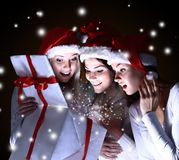 Girls with a new year gift Royalty Free Stock Photos