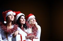 Girls with a new year gift Stock Photography