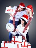 Girls with a new year gift Royalty Free Stock Photo