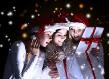 Girls with a new year gift Royalty Free Stock Photography
