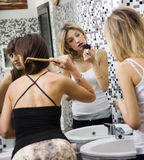 Girls night out. Girls applying makeup in the bathroom of a club Stock Photo