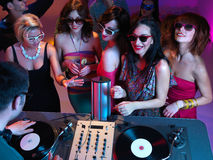 Girls night out. Young attractive women dancing in front of the dj table at party Royalty Free Stock Photography