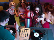 Girls night out. Young attractive women dancing in front of the dj table at party Stock Image