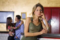 Girls night out. Girl alone in a pub Stock Image