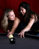 Girls night out. Beautiful Woman teaching her friend how to play pool Stock Photos