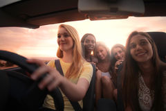 Girls night out. Beautiful young girls travelling at a car Royalty Free Stock Image