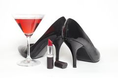 Girls night out. Concept with shoes, drink and lipstick Stock Image
