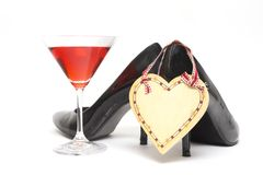Girls night out. Concept with shoes, drink and lipstick Royalty Free Stock Photo