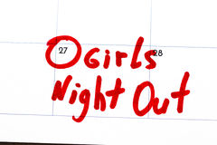 `girls night out ` is the text written on the calendar in red marker.  Royalty Free Stock Image
