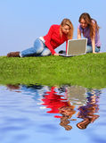 Girls with notebook Royalty Free Stock Image