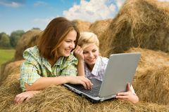 Girls with notebook in farm royalty free stock photo