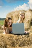 Girls with notebook in farm Stock Images