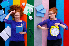 Girls with notes and clock Royalty Free Stock Images