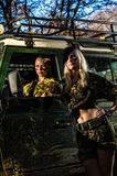 Girls and off-road vehicle Stock Photography