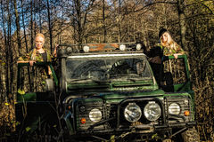 Girls and off-road vehicle Royalty Free Stock Photography
