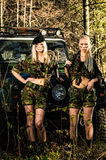 Girls and off-road vehicle Royalty Free Stock Photos