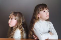 The girls offended to each other Royalty Free Stock Photography