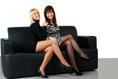 Girls On A Sofa Royalty Free Stock Image