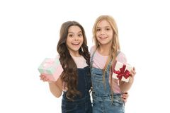 Girls open holiday present. Children cheerful hold presents. Opening gifts. Perfect present for teens. Shopping day. Birthday present. For my dear friend stock photo