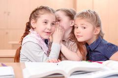 Girls with opened books in classroom Stock Photos