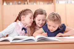 Girls with opened books in classroom Stock Photography