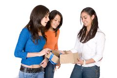 Girls opening a gift Stock Photo