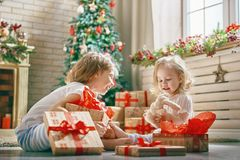 Girls opening gifts Stock Image