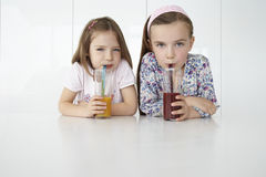 Girls With Orange And Chocolate Drinks At Table Stock Photography