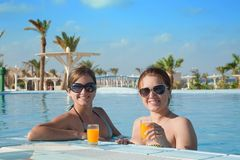 Girls with orange juice  at resort hotel Stock Photo