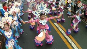 Girls in ornate coconut costume dance along the street, a festival to honor a patron saint stock video