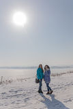 Girls outdoors in cold winter day Royalty Free Stock Photos